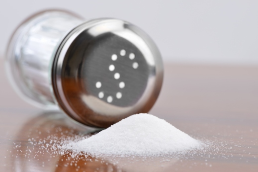 Salt being poured out of a salt shaker